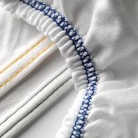 Spannbettlaken MALAGA 190 Single-Jersey weiß, gelb gesäumtes Feinrippband